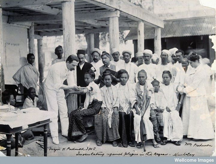 People in Mandalay being 'vaccinated' against the plague by a British physician in the early 1900s.