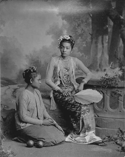 """A Burmese lady, her servant, and two citrus fruits"" - a photograph by Phillip Adolophe Klier c.1890."