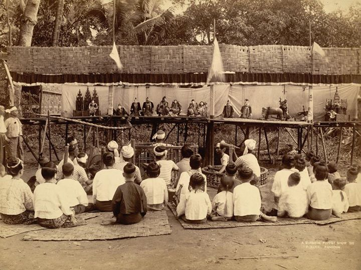 Before TV and the internet: kids (and others) watching a puppet show in Rangoon 1895.