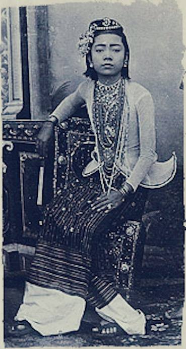 """Portrait of a Burmese entertainer taken at the Johannes & Co. Studio on """"C Road"""" in Mandalay c. 1895"""